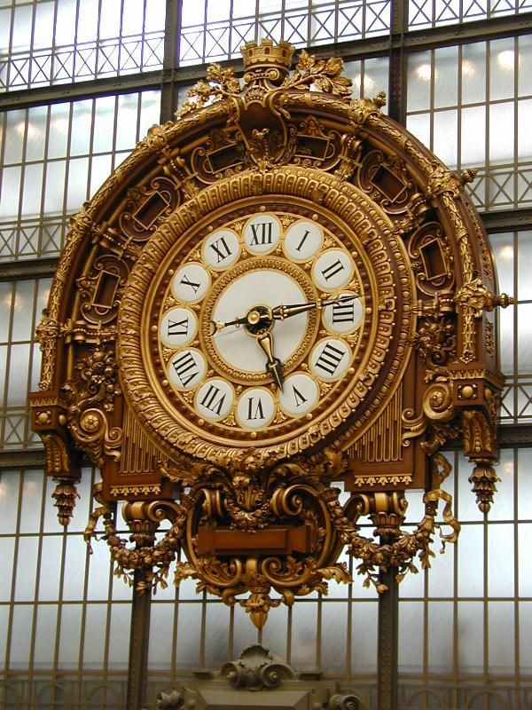 Paris, France: Musee d'Orsay: clock (1898-1900, architect Victor Laloux). The Musee d'Orsay used to be a train station.