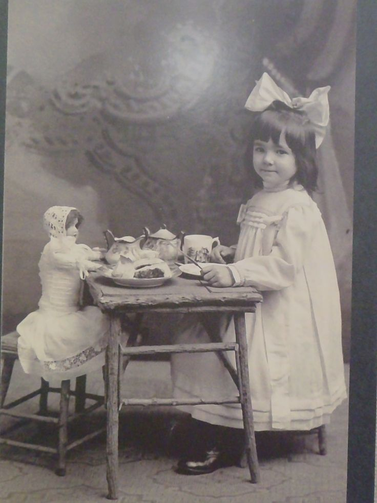 Tea, anyone? Sweet little Miss and her dolly pose for the camera. Cole House Museum, Moundridge, Kansas