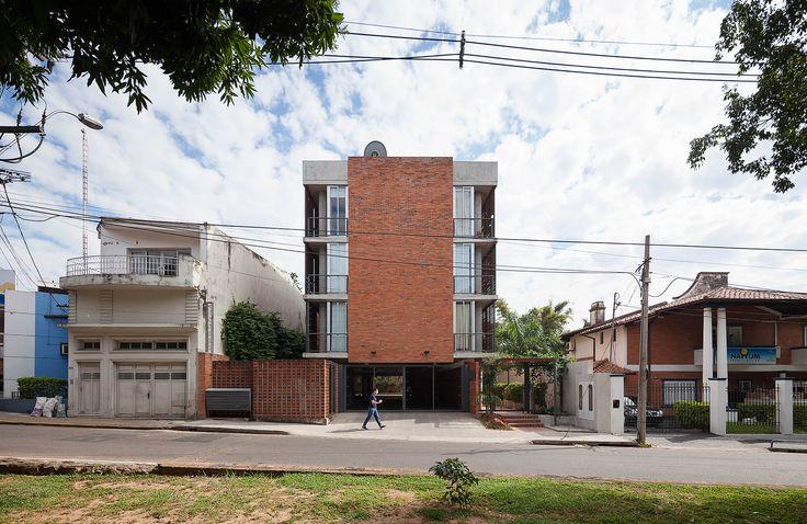 Galeria de Edificio Rosas 121 / - = + x - - 1