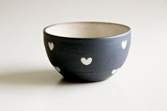 Ceramic bowl with black-and-white hearts.