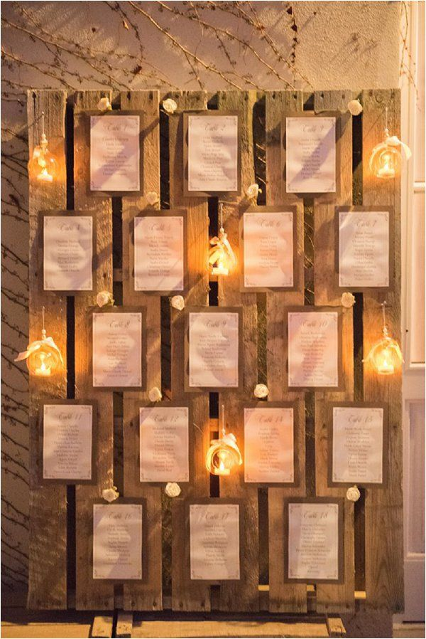Winter wedding table plan decorated with golden tea lights | Image by Sophie Reynaud