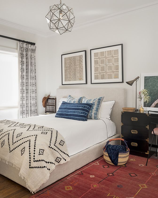 African-inspired bedroom. Indigo pillows and cloth, mudcloth framed art