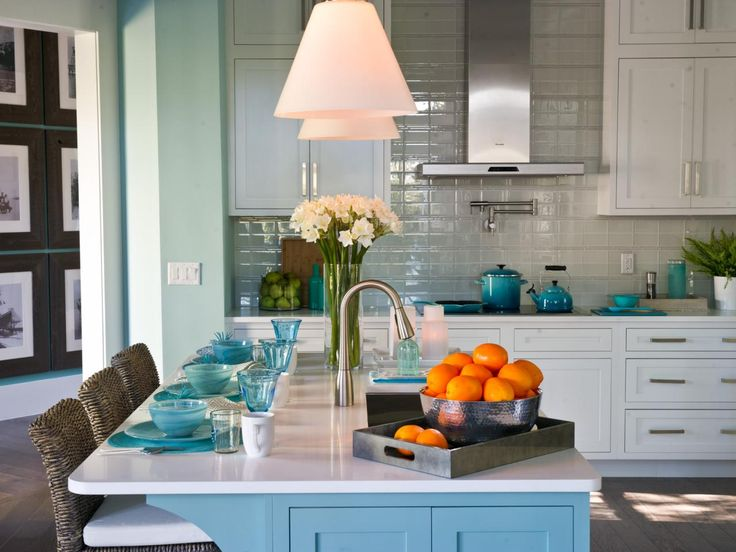 Blue & Mint & White: This is a classic, elegant kitchen with a white as its main base but a balanced use of color to add depth and interest. The wicker chairs and hardwood floors add a wonderful warmth to compliment the blues.