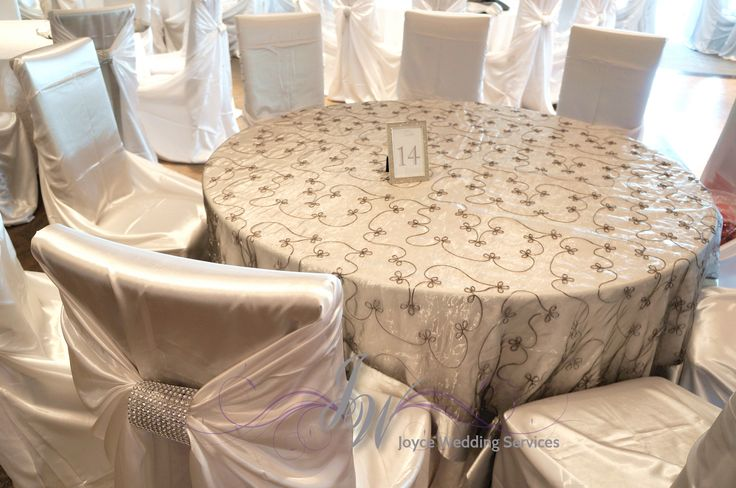 #weddingdecor #reception #ivory #satin #chaircovers with #rhinestonebuckle #tableoverlay