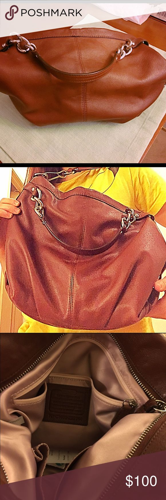 Leather coach hobo purse Beautiful purse! Leather hobo bag. Multiple pockets inside w silky light pink interior. Used but still looks brand new. Even still has the leather smell. Coach Bags Hobos