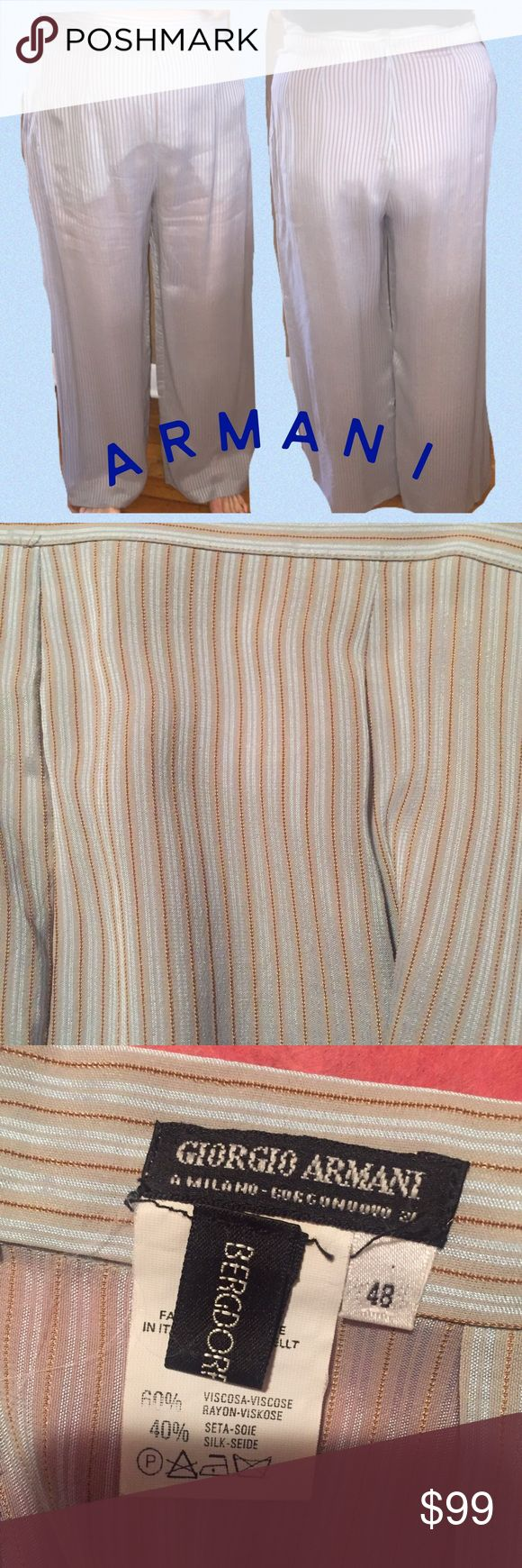 👸🏼Armani Silk Pants. Light blue/taupe striped 48 👸🏼Armani Silk Pants. Light blue/taupe striped. Size 48. Side zipper. New condition. Worn once. 100% silk. Absolutely gorgeous. Pictures don't do them justice. Size 48 is approximately a size 12/14. Model is a size 10. Giorgio Armani Pants Trousers