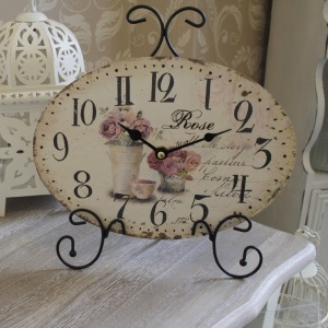 Cream mantel clock with rose detail on stand