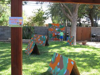 Nerf War Birthday Party - hand painted forts made from boxes, camo paint kids faces: Love idea of face painting for DD party!