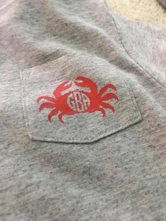 Monogrammed unisex childrens pocket tee! Vinyl crab design, color customizable. 3 letter max. Decal roughly 1.5x2.5inches.