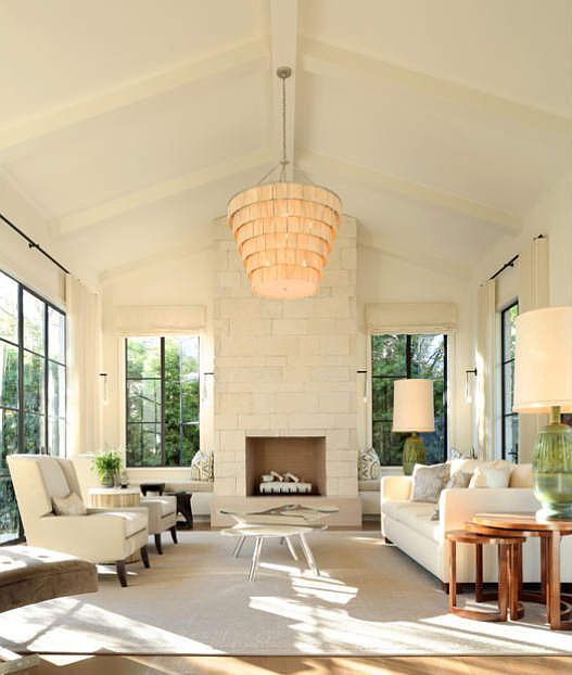 white living room, white stone fireplace