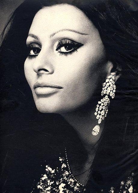 Sophia Loren is wearing a Creation of Galitzine and Cartier jewelry.  She was photographed by Von Wangenheim.Harper's Bazaar,December 1970.