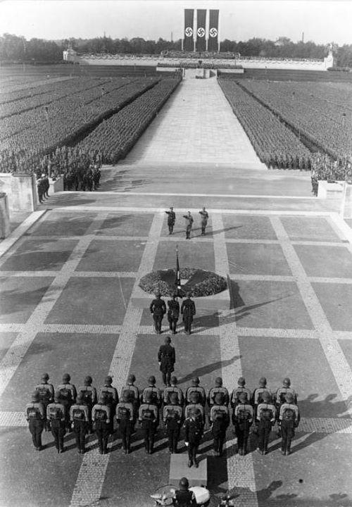 Heinrich Himmler Hitler and Viktor Lutze perform the Nazi salute at the Nuremberg Rally September 1934