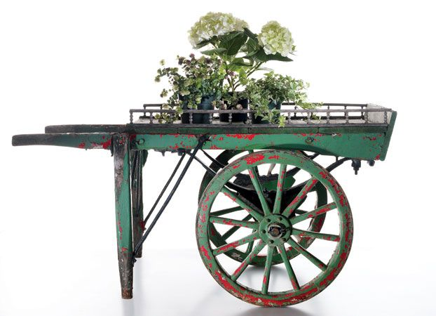 I'm going to need a more affordable version of this.     [Photo Credit: John Lawton | The rustic patina of this vintage mid-century pushcart from Terrain—once used at London's Chelsea Flower Market—makes it a stylish alternative to the traditional wheelbarrow. Put it to work, or stash it on the porch as a chic display for seasonal blooms ($1,400)]