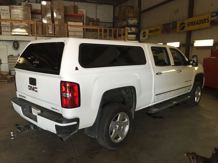 White GMC Sierra Denali with Leer Truck Cap installed at CPW Truck Stuff in Tinley Park, IL