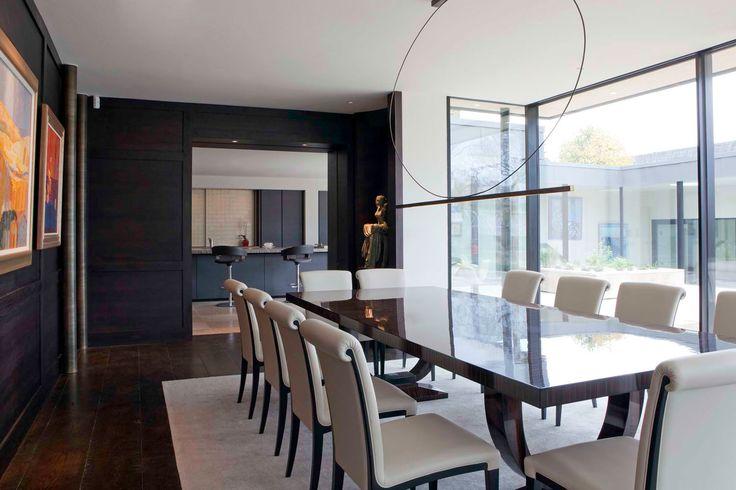 Minotti Cucine Kitchen, Atelier grey oak furniture, Platinum leaf sliding door cabinets, Gaya Brown honed/chisselled stone