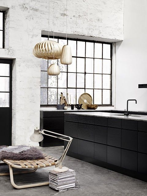 Love the textural mixes in this kitchen and the way the trio of pendants and the low woven seat complement each other - and soften the otherwise monochrome palette. Nice.