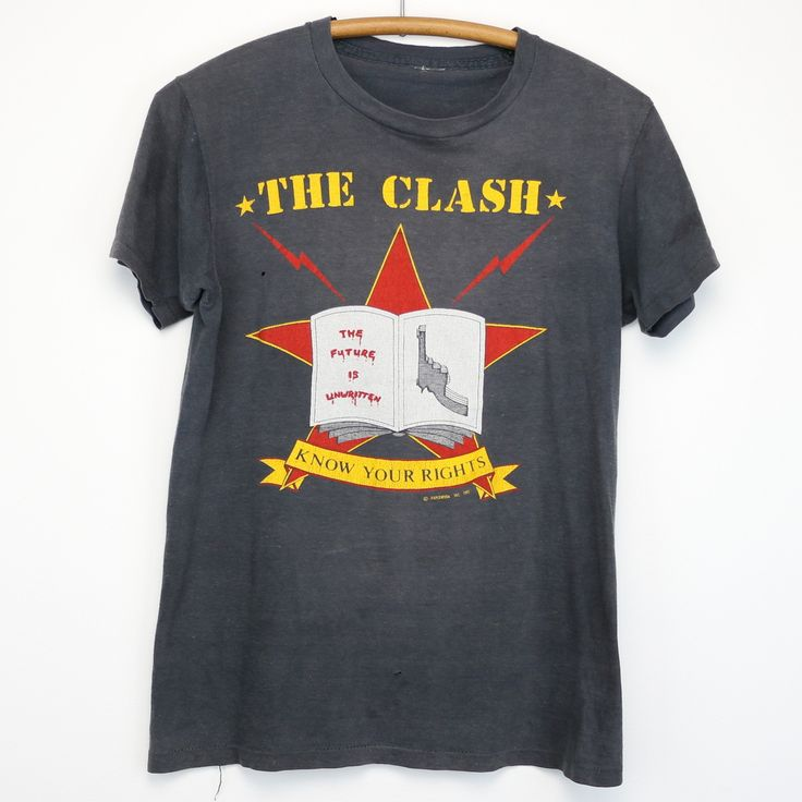 Original 1982 The Clash Combat Rock Tour Shirt. This is a true vintage shirt, not a modern reproduction. Sizes vary so please use measurements for best idea on fit. Front and Back Graphics. Shirt is ingoodcondition, no stains, small hole, discolored, spot on back.