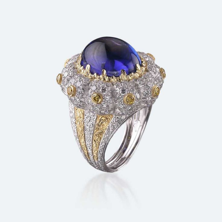 Cocktail ring with electric blue tanzanite in a white gold bezel, furtherly enhanced with yellow gold and diamonds. One of the most coveted crystals not only for its splendour but also for its spiritual power, tanzanite is a precious stone for whoever wishes to communicate with their unconscious and be conducted to a state of profound meditation by its vibrant energy. Http://www.facebook.com/diamonddreamfinejewelers http://www.twitter.com/diamond_dream_