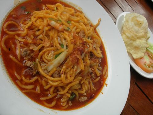 Mie Aceh is a spicy noodle dish typical of Aceh in Indonesia. Thick yellow noodles with slices of beef, mutton or seafood (shrimp and squid) are presented in a kind of soup is savory and spicy curry. Mie Aceh is available in two types, Aceh Mie Goreng (fried and dried) and Mie Aceh Kuah (soup). Usually sprinkled with fried onions and served with chips, chunks of red onion, cucumber, and lime.  Aceh - Indonesia