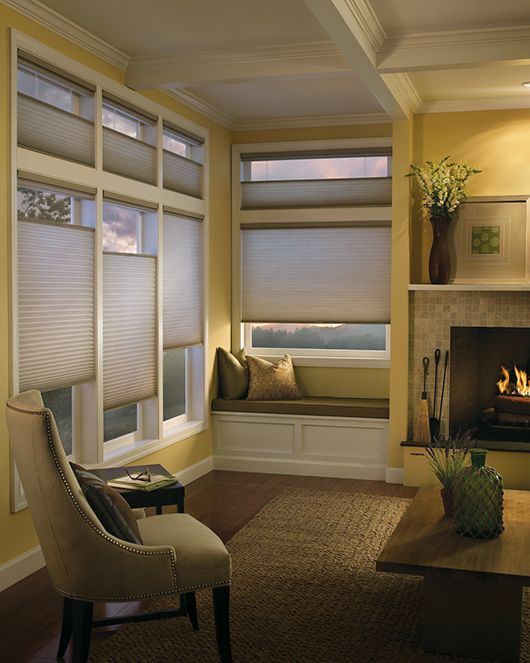 Keep the warmth inside this living room with Duette® honeycomb shades ♦ Hunter Douglas window treatments #fireplace
