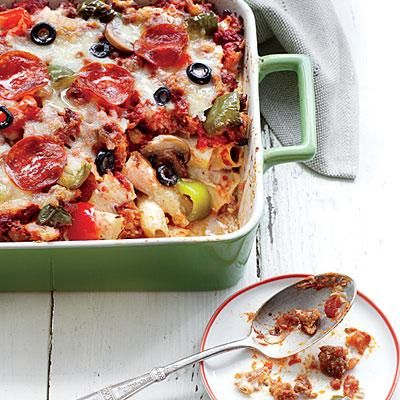 Pizza Casserole Deluxe | Win over all of the kids and grown-ups in your house with this new instant classic that feeds more than two everything pizzas. Fresh and packaged mozzarella give it the best melty consistency. | SouthernLiving.com