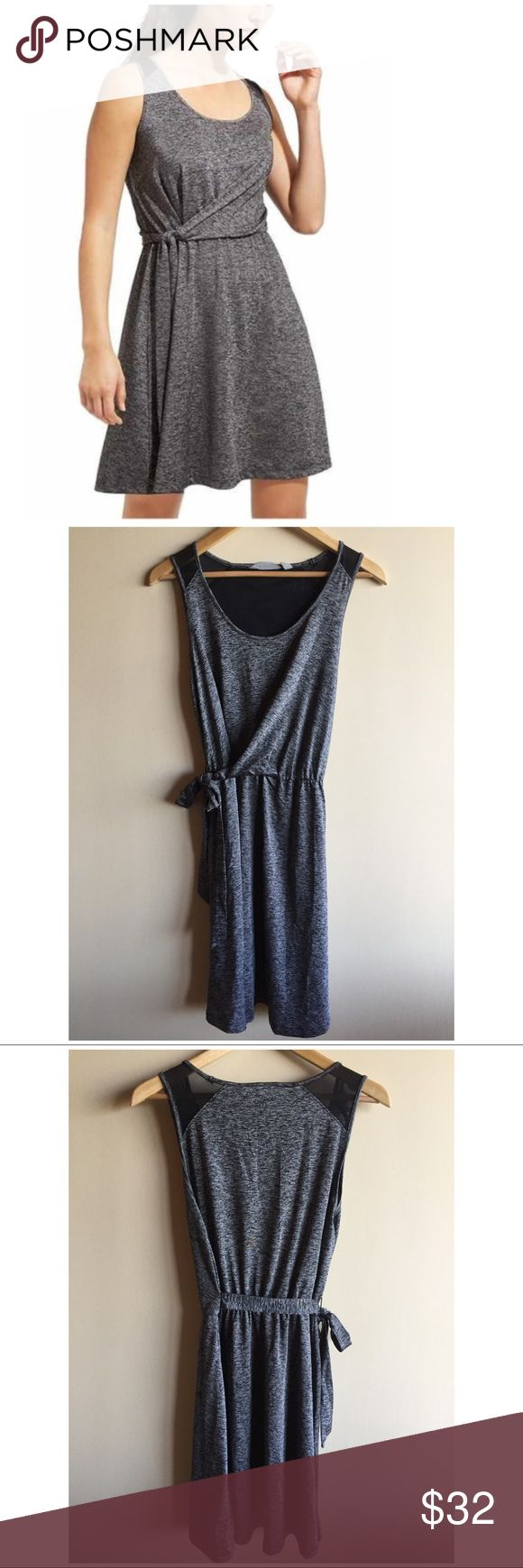 "Athleta Sweet Saturday wrap dress in grey Heathered charcoal grey faux wrap dress by Athleta in excellent condition! ""Designed for travel adventures, this flattering side-tie dress is made from a soft, packable jersey that's wicking so it works great wherever you take it. BRA-FRIENDLY. Wider straps conceal any and every kind of bra strap. Adjustable tie waist. Sporty mesh ventilation lets sweat escape."" Athleta Dresses"