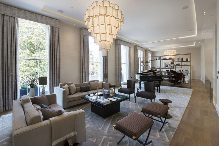 1508 London Park Crescent - luxury interior design, living room seating area with grand piano and chandelier.