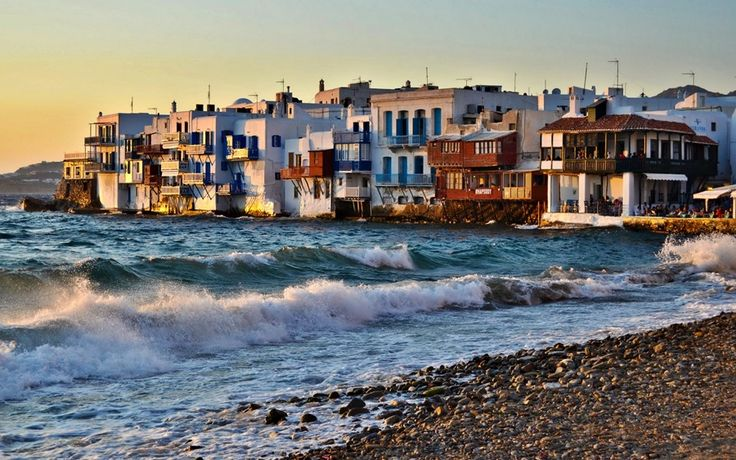 Mykonos, the diamond of the Aegean sea. With its traditional whitewashed houses creates the most magical scenery for holidays. Deep blue sky, cosmopolitan
