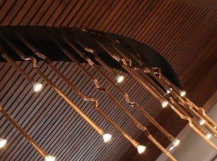 Copper tube stalk lighting.