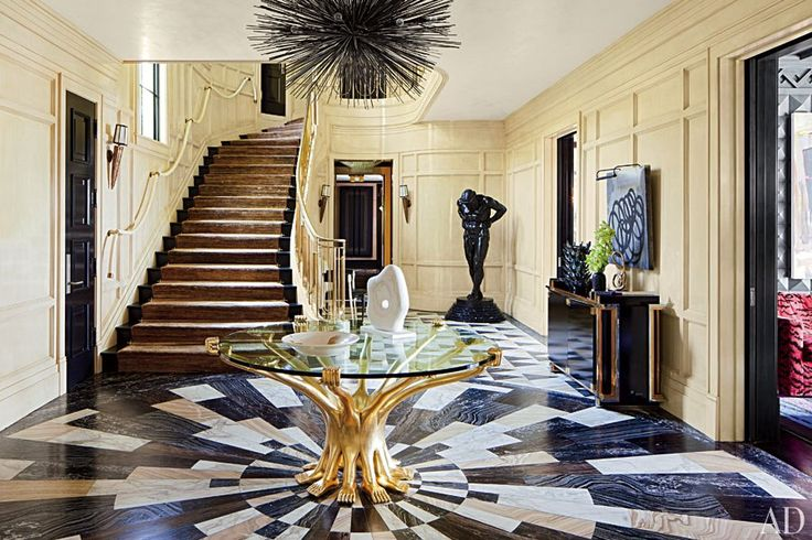 Designer Kelly Wearstler created a bold new look for a 1930s Bel Air, California, residence. The entrance hall revolves around a Pedro Friedeberg table and a Jean de Merry chandelier.