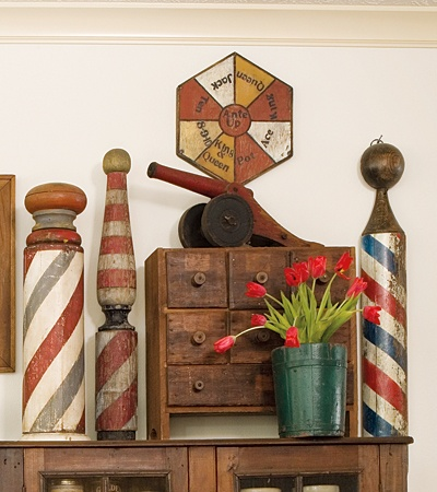 I like whatever game that is on top, looks easy to recreate for the gathering room. Kinda like the barber poles too!