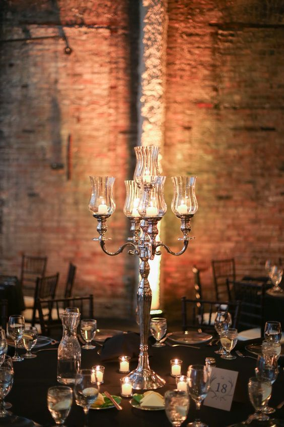 Silver Candelabra Centerpieces | Erin Johnson Photography | See More! http://heyweddinglady.com/romantic-industrial-glam-wedding-from-erin-johnson-photography/