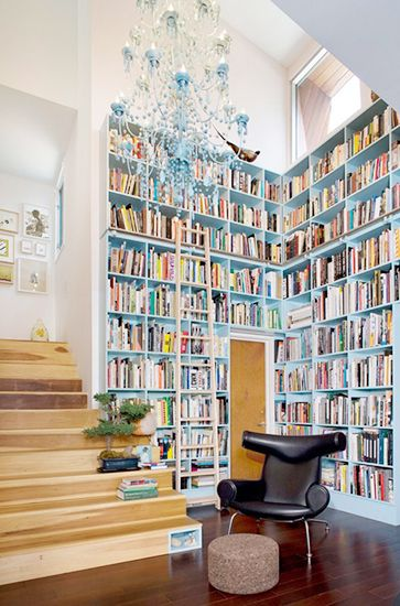 15 Lovely Libraries in Unexpected Places // corner bookcase Foyer painted doorway and stairs