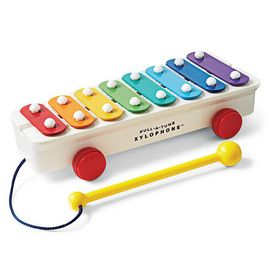 Introduced in 1957, this classic colourful xylophone will be an adventure in music making for your child. The xylophone features an attached mallet that won't get lost and easy roll wheels that allow your toddler to take it along. Kids can play a tune and easily take this xylophone with them Plays melodies Attached mallet, wheels Encourages music making skills Ages 18 months and up