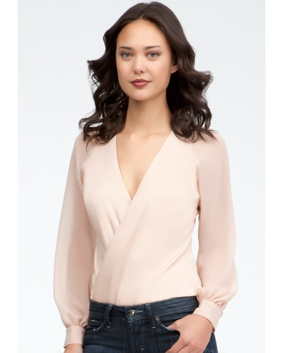 With polyester chiffon sleeves, a wrapped front and stunning hue, this bebe bodysuit is sure to make a feminine-chic alternative to tops. Try it with a pair of skinny jeans and nude pumps to achieve a flawless day look.