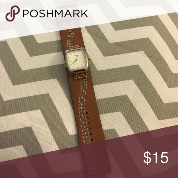 Woman's FOSSIL watch in Tan Tan FOSSIL watch with blue threading through band Jewelry Bracelets