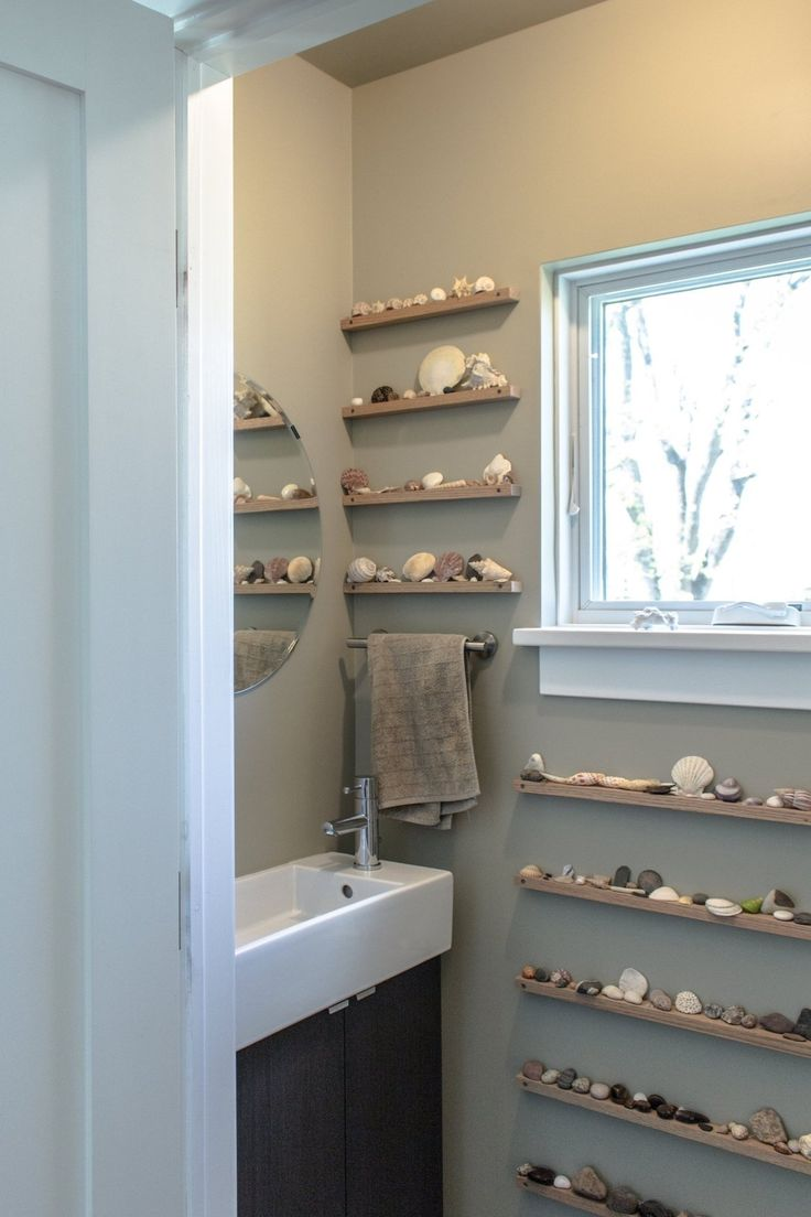 Kirsten and Ted's Green Dream  Displaying rocks and shells in the bathroom.
