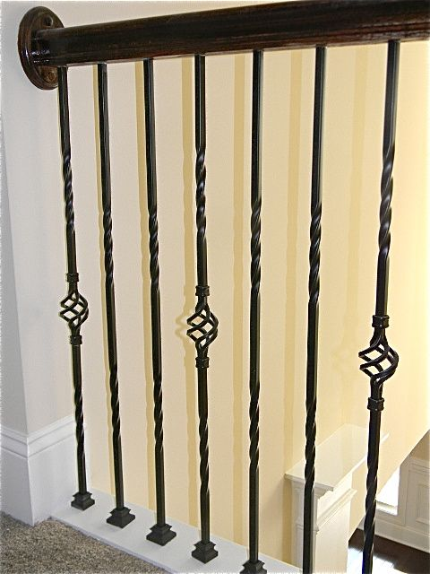 Wrought Iron Spindles With Basket Accents #essexhomes #home #charlotte #northcarolina #southcarolina #new #newhome #builder #wroughtiron #spindles #basket #accents #stairrailing