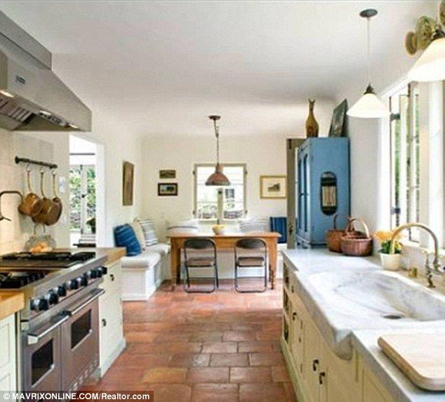 Stunning kitchen and molded sink with terracotta tiles and loads of natural light!