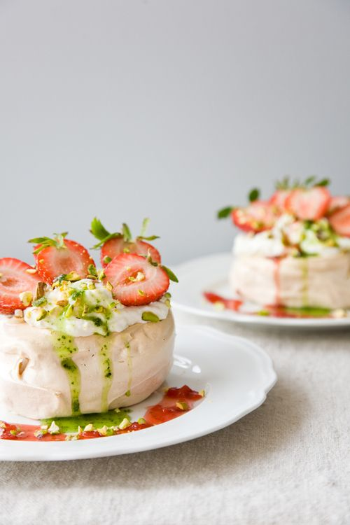 Pavlovas with Strawberries, Vanilla Cream, and Basil Coulis.
