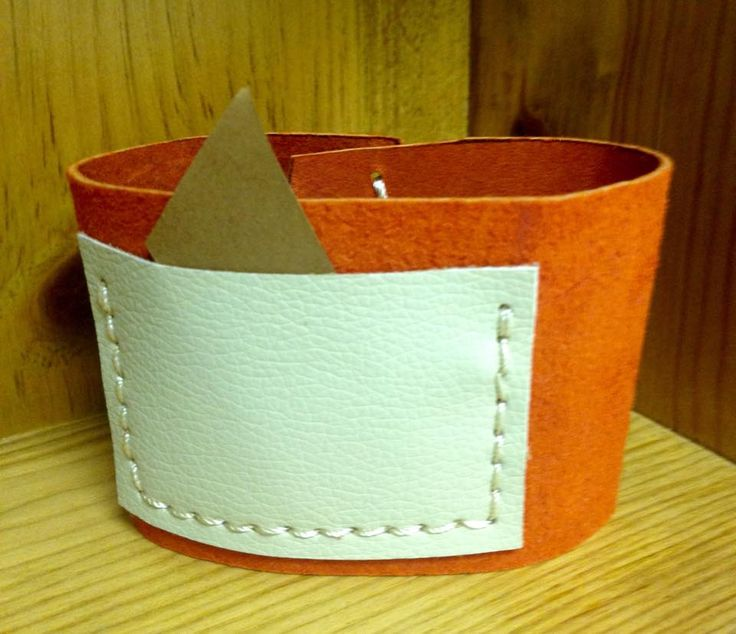 Handstitched leather coffee cup cozy with handy pocket.  $12 From www.facebook.com/stashbug