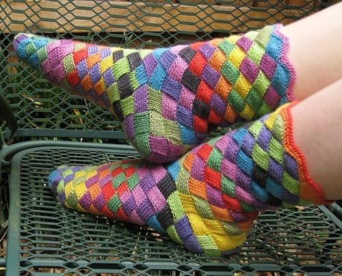 Entrelac knitting socks, basket prop