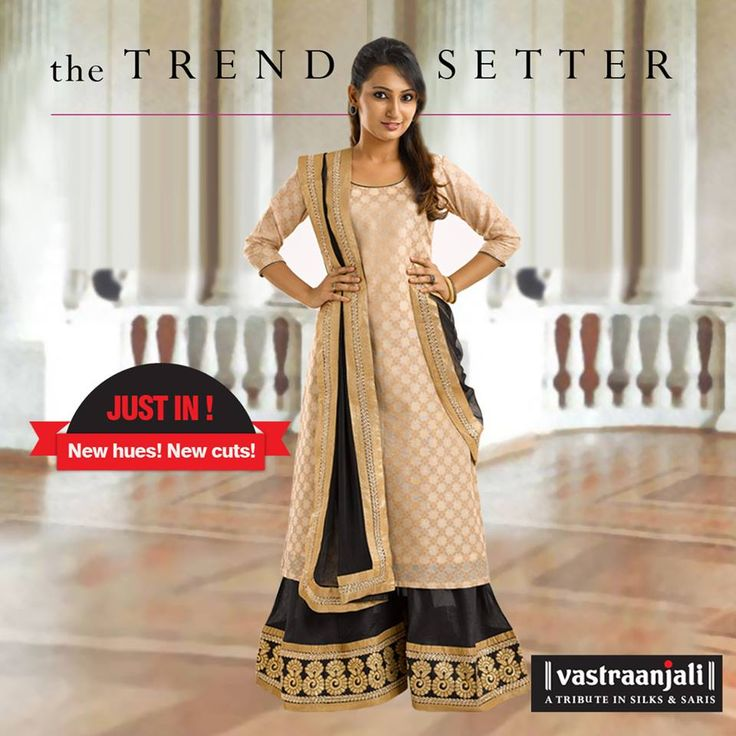 "BLACK & BEIGE JACQUARD KURTA SET. Featuring a beige benarasi jacquard kurta with antique golden piping on its round neck and sleeves. It comes along with a black poly silk sharara bottom with a 4"" metallic thread embroidered border, golden tissue taping and metallic embroidered lace on the hemline.  The dupatta in free flowing net has golden tissue taping and metallic lace on all four sides. The Price : INR. 2865."
