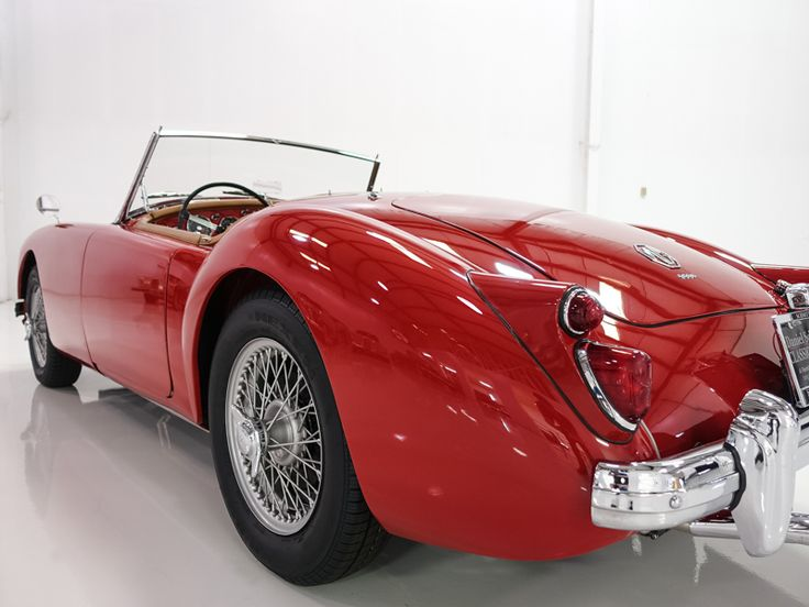 The 1961 MG MGA 1600 Roadster featured here is finished in stunning Chariot Red with a gorgeous Light Beige leather interior and matching convertible top. This magnificent motorcar has been meticulously restored, and is documented...