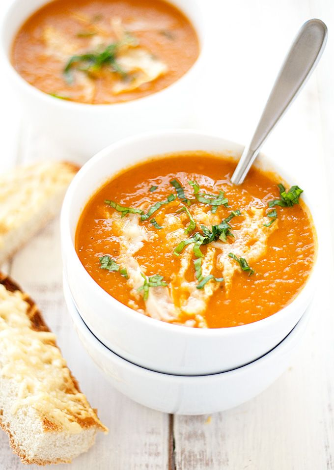 A classic with a twist - this roasted heirloom tomato soup is starts with roasted tomatoes, onion and garlic and ends with a creamy, delightful soup - yum!
