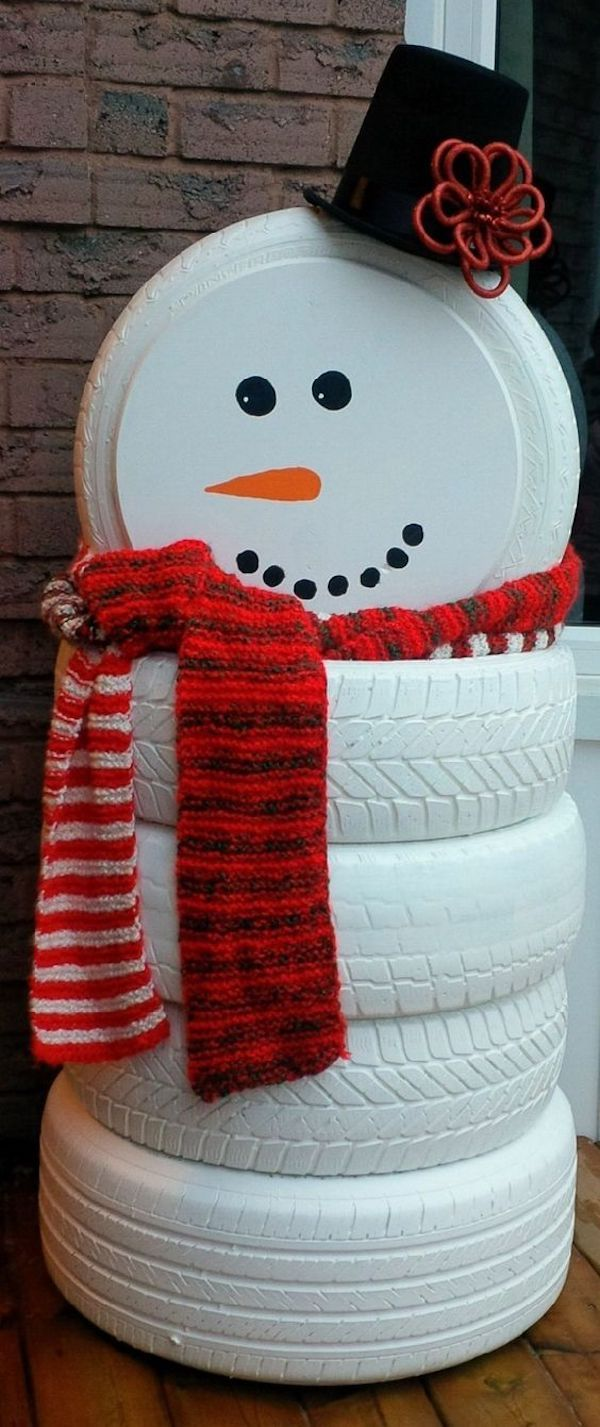 Old tires don't have to go to the landfill when they're no longer useful for transportation. You can color them in white and turn them into a snowman for your outdoor holiday decor!