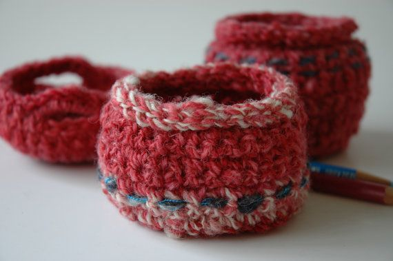 Small crochet bowls in pink and blue handspun by KororaCrafters