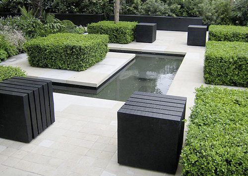 Clean look, water feature cut into the concrete, love the nicely shaped boxwoods (love love boxwood shrubs)