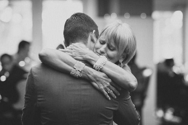 sweet wedding photo of groom and mother of groom - photo by Studio 222 | via junebugweddings.com