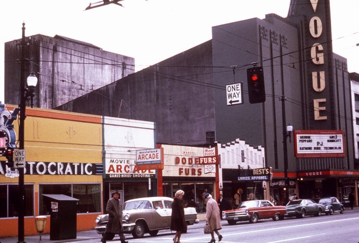1967 image of Aristocratic Restaurant (900 Granville Street), Movieland Arcade (904 Granville Street), Mandel Dodek Furs (906 Granville Street), Best's Ladieswear Apparel (910 Granville Street), Orpheum Lingerie Shops (916 Granville Street), and Vogue Theatre (918 Granville Street), Vancouver
